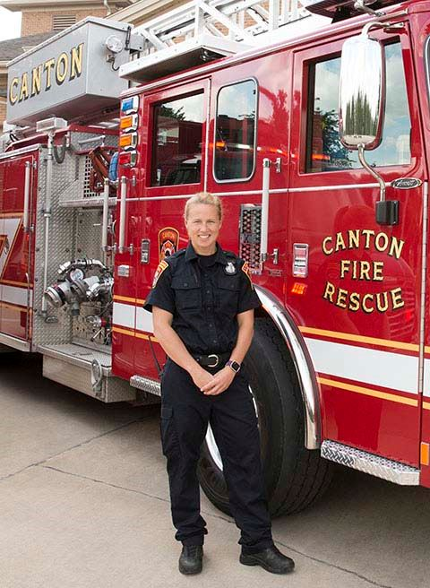 Canton Township Michigan Firefighter Paramedic standing by fire engine