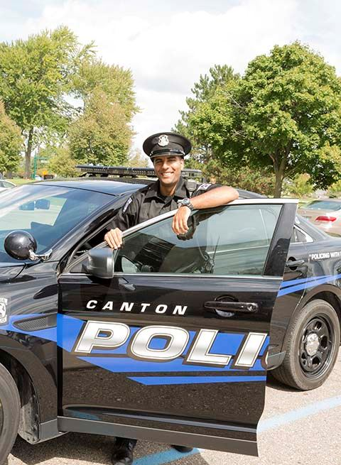 Canton Township Michigan Police Officer by police car